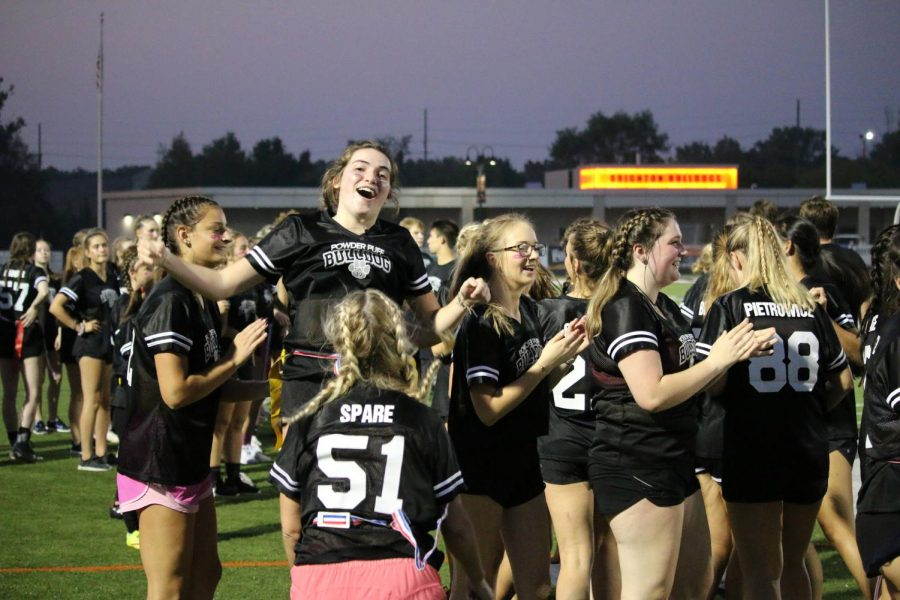 Senior+girls+celebrate+a+victory+in+the+2019+Powder+Puff+game.