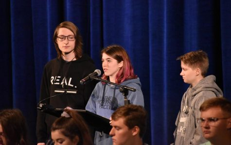 Ally Harris (12), supported by Ty Catner (12) and Alex Crouse (11), addresses freshmen at the Yellow Ribbon assembly on October 22. Speakers shared resources and stories in the spirit of suicide and mental illness awareness.