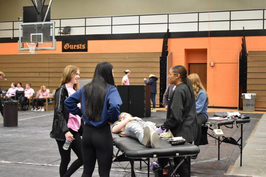 Two leadership students stand with a student as she gives blood while lying on one of the beds. This is the third set in the blood donation process. Leadership students dedicated their time Wednesday in order to be a support system for students.