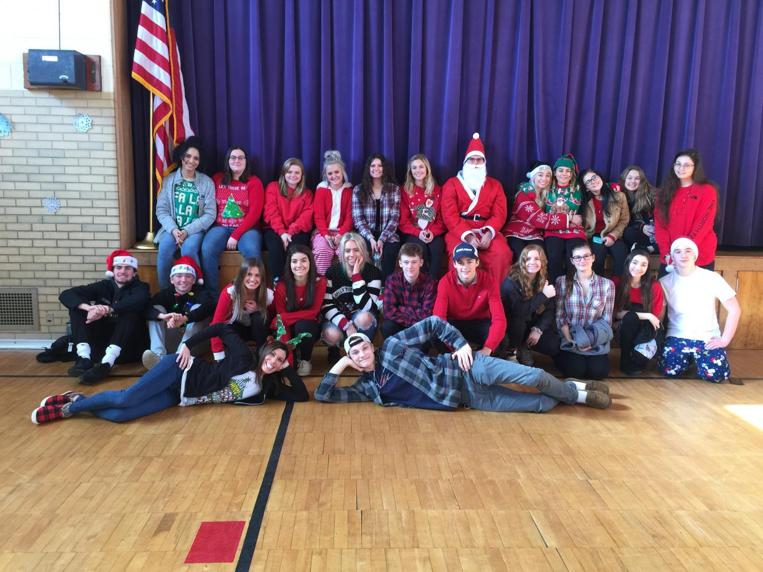 Students in Grills' class in 2018 deliver gifts to the Ford Early Learning Center in Ypsilanti, Michigan.