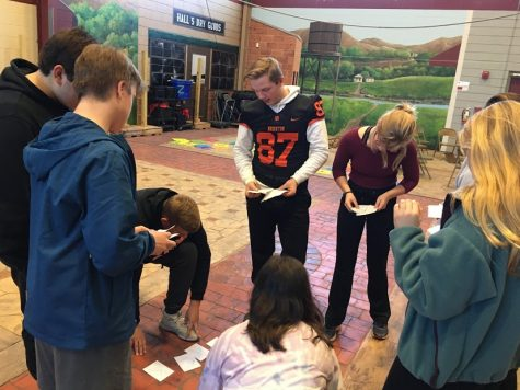 The Brighton High School DECA students participate in an activity while sitting in a circle.