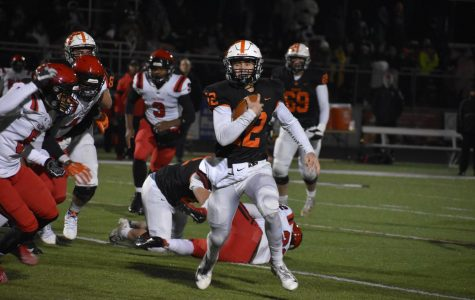 Colby Newburg, senior quarterback, running for one of his five touchdowns in the District championship game. Brighton won 48-26 and will play against Hudsonville on Nov. 15 in the Regional final.