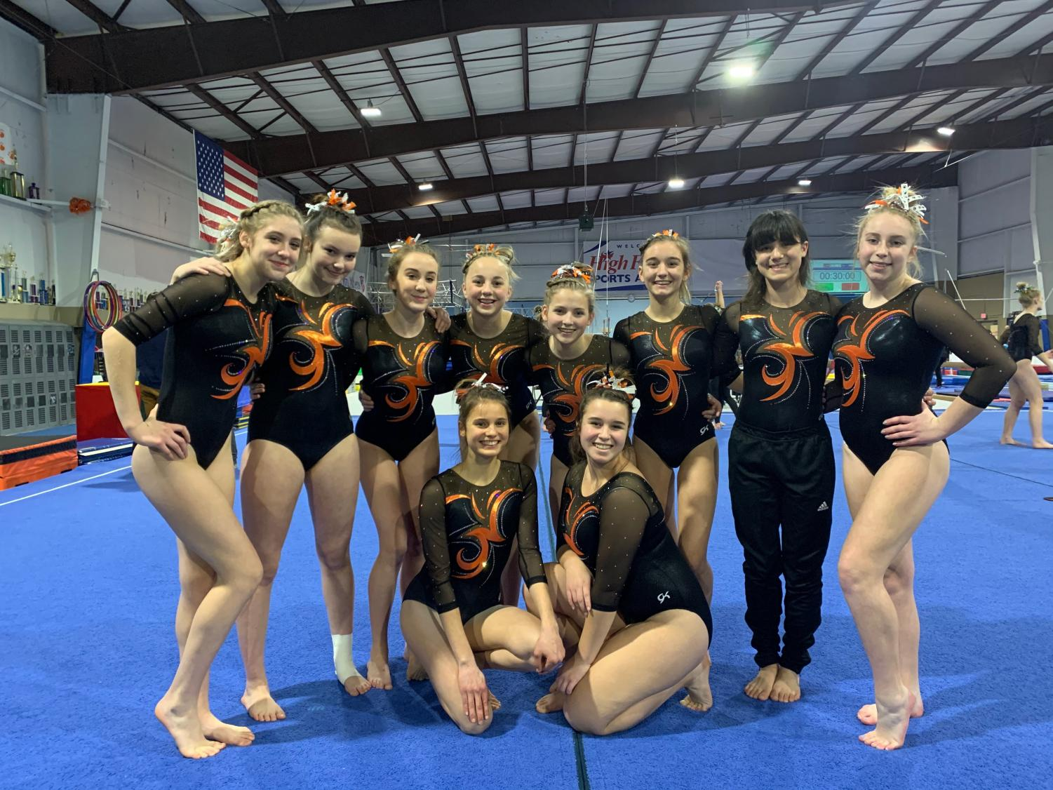 After the meet, the Brighton Gymnastics gather for a group picture to commemorate their first successful meet of the season.