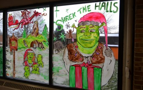 """The Art Club painted some of the windows in our sunshine hall for the Christmas season, they thought it'd be fun to do a shrek themed window which has turned into a big hit with all the students who pass the windows in the hall. Junior Emily Whitlow, said """"I saw the window painting and was amazed, I love the shrek movie and seeing that the art club chose that as a theme made me so happy!"""""""