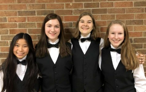 Freshman Anna Redkozubova(2nd from the right) and her Solo and Ensemble group pose for their picture after achieving a one, the best rating, in their group performance.